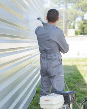 exterior house cleaning with pressure washer