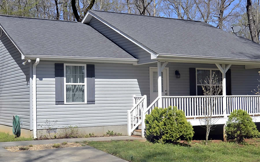 home with new gray vinyl siding installed